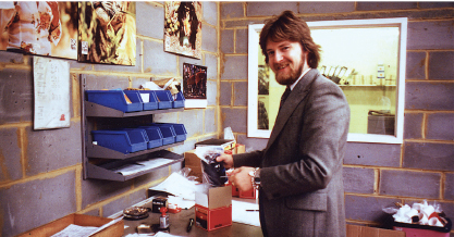 "Graham Armitage, seen here in late 1970's when he was Product Manager for SIGMA (Along with Sunpak flashguns and Elmo Cine) at CZ Scientific Instruments Ltd. In Borehamwood. ""As you can see I'm actually holding a SIGMA lens in the livery of the day"", he adds"